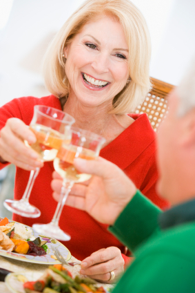 Couple Toasting At Christmas Dinner